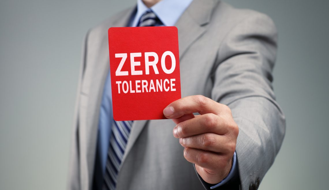 Businessman showing the zero tolerance red card