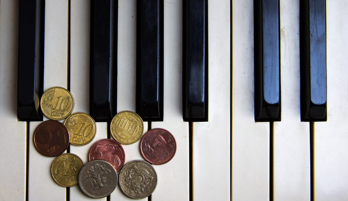 Piano keys and coins