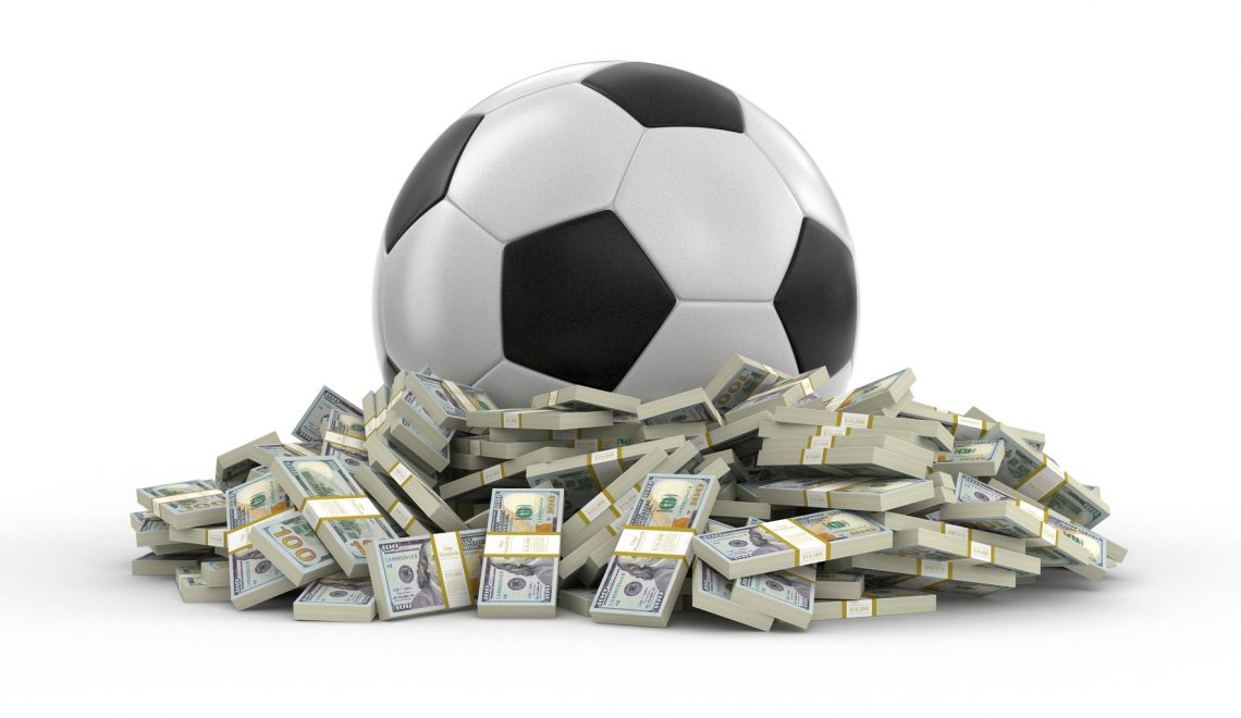 Soccer football with dollars. Image with clipping path