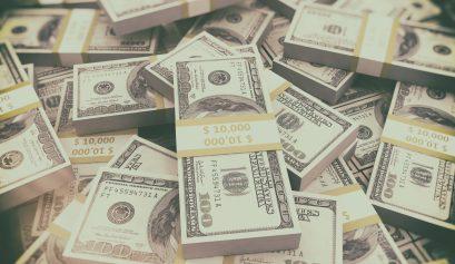 Money background. US dollars stacked
