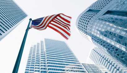 View of American flag on blue building background