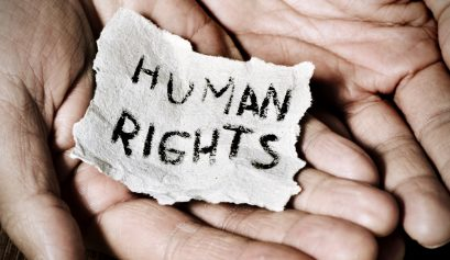 young man with a paper with the text human rights
